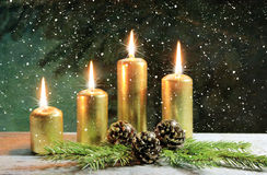 Gold candles. Advent four gold candles with snow stock photography