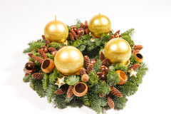 Gold candles on wreath Royalty Free Stock Images