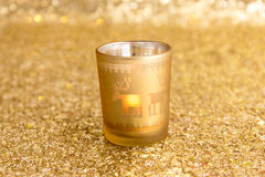 Gold candlestick. On the gold background Royalty Free Stock Images