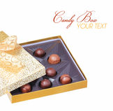 Gold Candy Box with Truffles isolated on white. Christmas Royalty Free Stock Photo