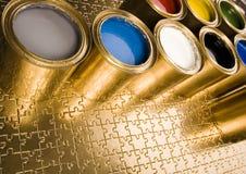 Gold cans Stock Photos