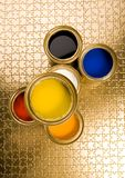 Gold cans Royalty Free Stock Photography
