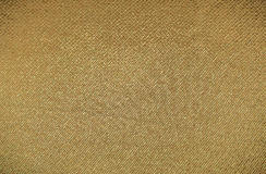 Gold canvas texture or background Royalty Free Stock Photos
