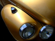 Gold car. Gold beetle car closeup stock photography