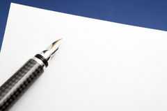 Gold Carbon Fiber Fountain Pen with Blank Paper.  Royalty Free Stock Photography
