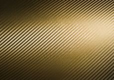 Gold carbon fiber texture Royalty Free Stock Photo