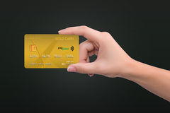 Gold card in woman hand Stock Images