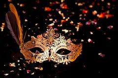Gold carnival mask. Gold carnival mask on black background royalty free stock images