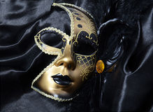 Gold carnival mask with black feathers Stock Images