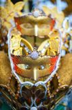 Gold carnival mask at a night carnival in Indonesia stock photo