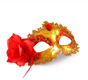 Gold carnival mask with red flower isolated on white Stock Photo