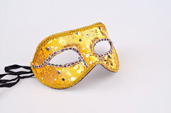 Gold carnival mask whit black ribbon Royalty Free Stock Image