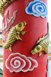 Gold carp on the background red color royalty free stock photography