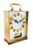 Gold carriage clock over white Royalty Free Stock Image