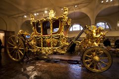 Gold Carriage in The Royal Mews in London. royalty free stock images