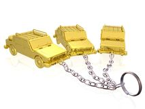Gold cars on keychain Stock Photo