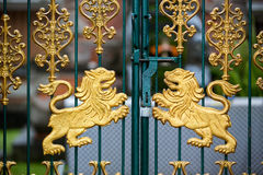 Gold carved lions at the gate of the temple Royalty Free Stock Photography