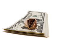 Gold and cash. Golden ring on cash package isolated on the white background Royalty Free Stock Images