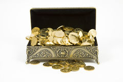 Gold casket and gold coins Royalty Free Stock Image