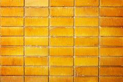 Gold ceramic brick tile wall Stock Photography