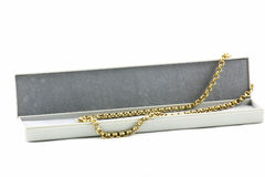 Gold chain. Gold belcher chain in a gift box Royalty Free Stock Photos