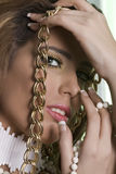Gold chain. Close up of a Beautiful  women fashion model wearing jewelery Royalty Free Stock Images