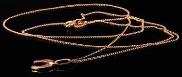 Gold chain on black Stock Photos