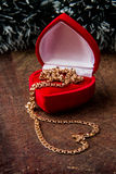 Gold chain in box. Gold chain in red box as a gift Royalty Free Stock Photo