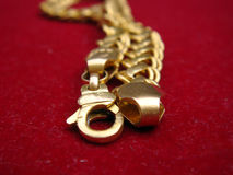 Gold chain focus on lock. Gold chain placed on white background, focus on chain lock stock photo
