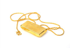 Gold chain and gold bar on white background Royalty Free Stock Photo