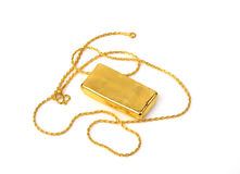 Gold chain and gold bar on white background Royalty Free Stock Photos