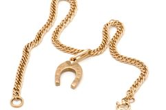 Gold chain with horseshoe Stock Photos