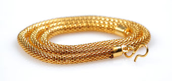 Gold chain jewellery. Isolated on white backgground Stock Photos