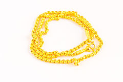 Gold chain on a white background Royalty Free Stock Photos