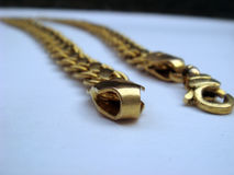 Gold chain on white background. Gold chain placed on white background, focus on chain lock royalty free stock photography