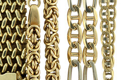 Gold chains. Gold chain on the white background Stock Image