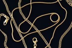 Gold chains. On blue felt texture closeup Stock Photography