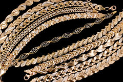 Gold chains and bracelets Royalty Free Stock Images