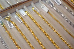 Gold chains have different kinds and forms Stock Image