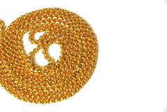 Gold chains on white background Royalty Free Stock Image