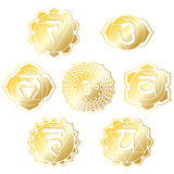 Gold Chakras. Set of seven chakras in shiny gold Stock Illustration