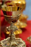 Gold chalices or goblets royalty free stock photo