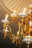 Gold chandelier. Large chandelier with candle shaped lights Stock Photography
