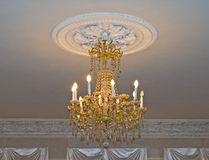 Gold chandelier. In old house Royalty Free Stock Photos