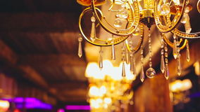Gold chandelier with crystal balls stock footage