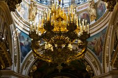 Gold chandelier in the old church Stock Photos