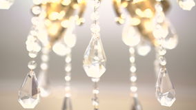 Gold chandelier on a white background. Slow motion stock video footage