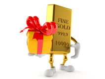 Gold character holding gift Royalty Free Stock Images