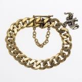Gold charm bracelet. Women's gold charm bracelet with elephant Stock Photography