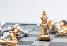 Gold Chess on chess board game for business metaphor leadership. Concept select focus on king chess shallow depth of field Royalty Free Stock Photos